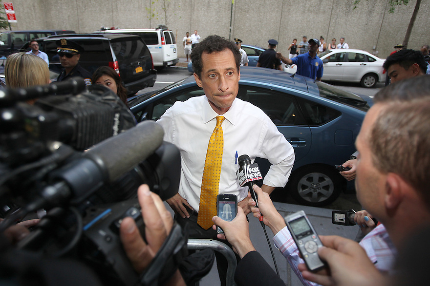 Anthony Weiner is seen talking to reporters after making a stop at Pace University on Wednesday, July 24, 2013in New York. (AP Photo/ Donald Traill)