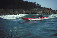A kayaker enjoying the waves at Big River Beach, Mendocino California
