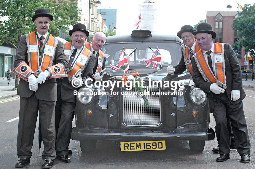 A large number of taxis take part in the Belfast, N Ireland, UK, Twelfth Parade. They provide relief for the foot weary and the less fit brethern. This one even has a &quot;cherished&quot; number plate. A popular mantra is Remember 1690, the year of the Battle of the Boyne in which the Protestant King William defeated the Roman Catholic King James and is the highlight of Orange folklore. 200107122725.<br /> <br /> Copyright Image from Victor Patterson, 54 Dorchester Park, Belfast, UK, BT9 6RJ<br /> <br /> t: +44 28 90661296<br /> m: +44 7802 353836<br /> vm: +44 20 88167153<br /> e1: victorpatterson@me.com<br /> e2: victorpatterson@gmail.com<br /> <br /> For my Terms and Conditions of Use go to www.victorpatterson.com