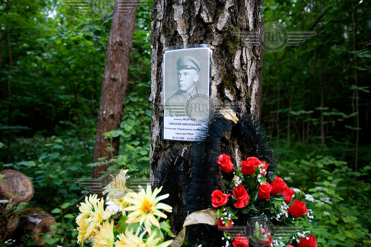 Flowers and a picture stand in a woodland in Kuntsevo, Moscow where tens of thousands of people are thought to have been mass-buried during Stalin's purges.