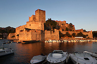 Chateau Royal with boats moored in the foreground, Collioure, France. Much of the castle was built in the 13th and 14th centuries by the Dukes of Roussillon and the Knights Templar. In the 16th century Collioure was under Spanish control and Philip II modernised and reinforced the castle. It was taken by the French in 1659 after which the bastions were built by Vauban (1633-1707). Picasso, Matisse, Derain, Dufy, Chagall, Marquet, and many others immortalized the small Catalan harbour in their works. Picture by Manuel Cohen.