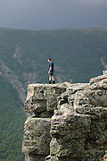 Pemigewasset Wilderness - A hiker enjoys the views from the summit of Bondcliff  during the summer months. Located in the White Mountains, New Hampshire USA along the Bondcliff Trail
