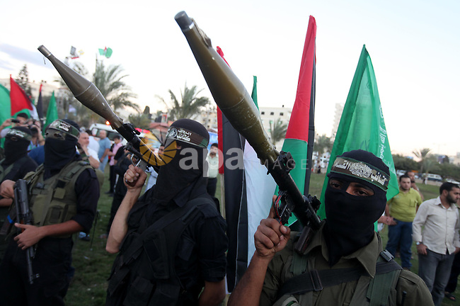 Palestinian Hamas militants stand guard outside the tent erected to welcome Palestinian prisoners released in exchange for the captured Israeli soldier Gilad Schalit in Gaza City, Wednesday, Oct. 19, 2011. Photo by Majdi Fathi