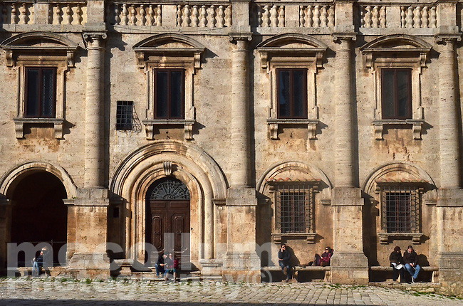 Michael McCollum.3/16/13.Four couples enjoy the afternoon sun in Palazzo de Nobili Tarugi, Palace of the Tarugi Nobles, in Piazza Grande in Montepulciano, Val D'Orcia, Tuscany, Italy .