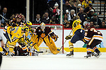 09 APR 2011: University of Michigan forward Jeff Rohrkemper's (22) scores a goal in the third period against the University of Minnesota Duluth during the Division I Men's Ice Hockey Championship held at the Xcel Energy Center in St. Paul, MN. Minnesota-Duluth beat Michigan in overtime, 3-2 to claim the national title. Vince Muzik/ NCAA Photos.