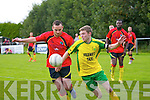 Joe McElligott (Na Fianna) in action with Darren Breen (Mitchels Ave) in the Tommy Healy Memorial Cup final at Mounthawk Park, Tralee on Saturday.
