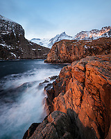 Winter light on coastal sea cliffs at Å, Moskenesøy, Lofoten Islands, Norway
