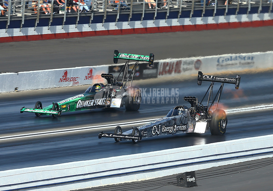 Feb 13, 2016; Pomona, CA, USA; NHRA top fuel driver Dave Connolly (near) races alongside teammate Leah Pritchett during qualifying for the Winternationals at Auto Club Raceway at Pomona. Mandatory Credit: Mark J. Rebilas-USA TODAY Sports