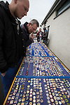 'Groundhoppers' looking at pin badges for sale before the Spartans versus University of Stirling Scottish Lowland League match at Ainslie Park, Edinburgh. The match was one of six attended by members of GroundhopUK over the weekend to accommodate groundhoppers, fans who attempt to visit as many football venues as possible. Around 100 fans in two coaches from England participated in the 2016 Lowland League Groundhop and they were joined by other individuals from across the UK which helped boost crowds at the six featured matches.