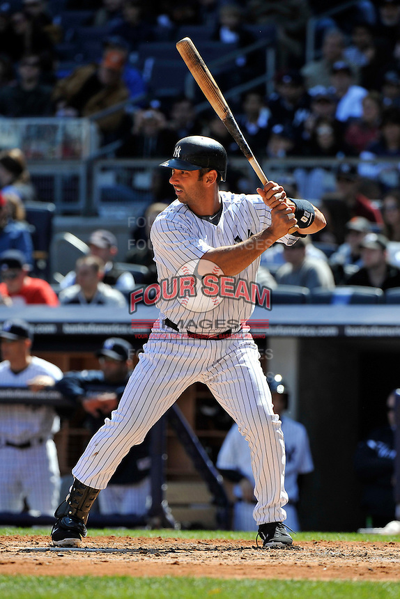 Apr 03, 2011; Bronx, NY, USA; New York Yankees catcher Jorge Posada (20) during game against the Detroit Tigers at Yankee Stadium. Tigers defeated the Yankees 10-7. Mandatory Credit: Tomasso De Rosa