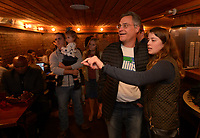 NWA Democrat-Gazette/ANDY SHUPE<br /> State Rep. Charlie Collins, R-Fayetteville, speaks Tuesday, Nov. 6, 2018, with his daughter, Jamie, as they watch returns come in on television during a watch party for the Washington County Republican Party of Arkansas at Powerhouse Seafood in Fayetteville.