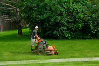 Two young men at work with their lawn maintenance landscaping business.