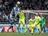 Garry Thompson of Wycombe Wanderers wins the header with Luke Prosser of Colchester United during the Sky Bet League 2 match between Wycombe Wanderers and Colchester United at Adams Park, High Wycombe, England on 27 August 2016. Photo by Liam McAvoy.