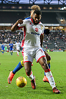 Ethan Ebanks-Landell of MK Dons shields the ball from Lyle Taylor of AFC Wimbledon during the Sky Bet League 1 match between MK Dons and AFC Wimbledon at stadium:mk, Milton Keynes, England on 13 January 2018. Photo by David Horn.