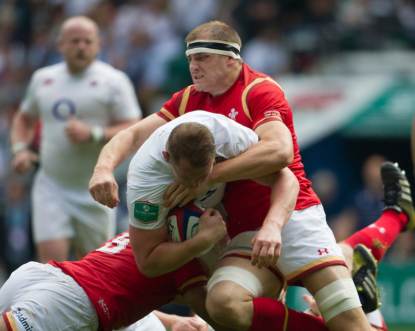 Dylan Hartley of England is tackled by James King of Wales<br /> <br /> Photographer Ashley Western/CameraSport<br /> <br /> International Rugby Union Friendly  - Old Mutual Wealth Cup - England v Wales - Sunday 29th May 2016 - Twickenham, London<br /> <br /> World Copyright &copy; 2016 CameraSport. All rights reserved. 43 Linden Ave. Countesthorpe. Leicester. England. LE8 5PG - Tel: +44 (0) 116 277 4147 - admin@camerasport.com - www.camerasport.com