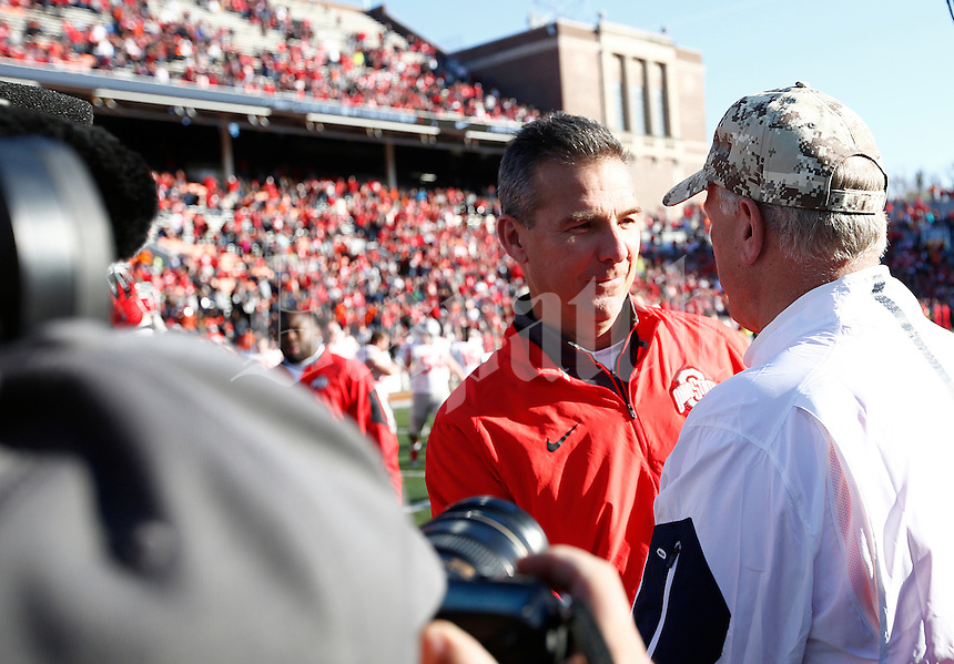 Ohio State Buckeyes head coach Urban Meyer and Illinois Fighting Illini head coach Bill Cubit shake hands after the college football game between the Ohio State Buckeyes and the Illinois Fighting Illini at Memorial Stadium in Champaign, Ill., Saturday morning, November 14, 2015. The Ohio State Buckeyes defeated the Illinois Fighting Illini 28 - 3. (The Columbus Dispatch / Eamon Queeney)