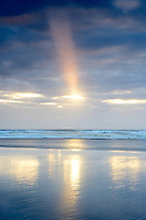 Low tide reflection with sunburst. Rockaway Beach. Oregon
