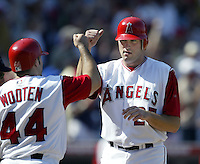 Troy Glaus of the Los Angeles Angels is greeted by teammate Shawn Wooten after hitting a home run during a 2002 MLB season game at Angel Stadium, in Anaheim, California. (Larry Goren/Four Seam Images)