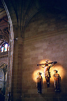 Spain, Segovia. Interior scene in the cathedral, a gothic edifice completed 1577. Christ on the cross in carved wood. Segovia Castilla Y Leon Spain.