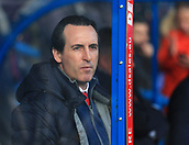 9th February 2019, The John Smith's Stadium, Huddersfield, England; EPL Premier League football, Huddersfield versus Arsenal; Arsenal Manager Unai Emery peers through the perspex window of the dugout prior to the kick off