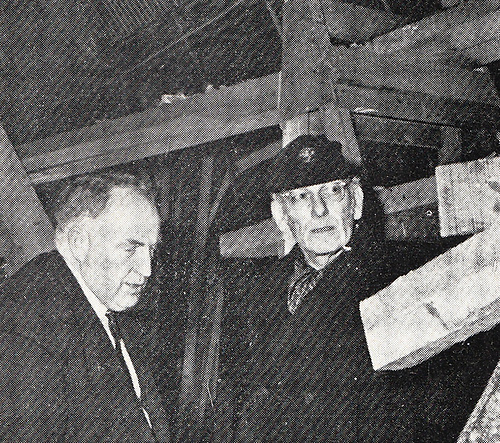 Denis Doyle and Francis Chichester considering Gipsy Moth V's new-style fin-and-skeg configuration