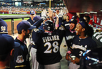 May 9, 2010; Phoenix, AZ, USA; Milwaukee Brewers first baseman Prince Fielder (28) is congratulated by teammates in the dugout after hitting a home run in the second inning against the Arizona Diamondbacks at Chase Field. Players are wearing pink arm bands and using pink bats in honor of breast cancer awareness and Mothers Day. Mandatory Credit: Mark J. Rebilas-