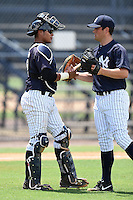 GCL Yankees 2 catcher Rainiero Coa (76) shakes hands with pitcher Mike Noteware (11) after closing out a game against the GCL Braves on June 23, 2014 at the Yankees Minor League Complex in Tampa, Florida.  GCL Yankees 2 defeated the GCL Braves 12-4.  (Mike Janes/Four Seam Images)