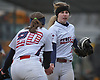 Jessica Budrewicz #9 of MacArthur, right, gets congratulated by third baseman Lisa Fabig #20 after pitching out a a jam in a non-league varsity softball game against Massapequa at MacArthur High School on Tuesday, March 20, 2018. MacArthur won by a score of 3-0.