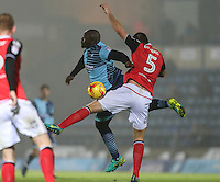 Adebayo Akinfenwa of Wycombe Wanderers and Ryan Edwards of Morecambe battle for the ball during the Sky Bet League 2 match between Wycombe Wanderers and Morecambe at Adams Park, High Wycombe, England on 12 November 2016. Photo by David Horn.
