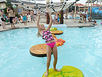 NWA Democrat-Gazette/BEN GOFF @NWABENGOFF<br /> Caylin Hayter, 10, of Springdale negotiates her way across floating pads on Sunday Sept. 6, 2015 at the Rogers Aquatic Center. The water park will be open for the last day of the 2015 season on Monday from 11:00a.m. to 7:00p.m.