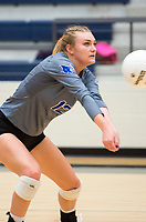 NWA Democrat-Gazette/CHARLIE KAIJO Rogers High School outside hitter Kassidy Wall (12) digs during the girl's volleyball game on Thursday, October 12, 2017 at Bentonville West High School in Centerton.