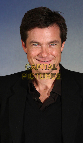 JASON BATEMAN .Photocall for 'Couples Retreat' at Claridges Hotel, London, England, UK, October 15th 2009.portrait headshot black jumper jacket brown shirt sweater v-neck smiling .CAP/ROS.©Steve Ross/Capital Pictures