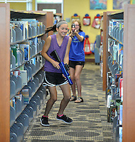 NWA Democrat-Gazette/MICHAEL WOODS &bull; @NWAMICHAELW<br /> Ruth Duncan (right), 12, from Fayetteville, takes a shot at Ariana Saitta, 12 from Fayetteville, during a laser tag game Friday, August 7, 2015, at the Fayetteville Public Library.  The after hours later tag games were part of the Teen Summer Reading Finale Party that included a variety of games, prizes and snacks for kids who completed grades 6 through 12.