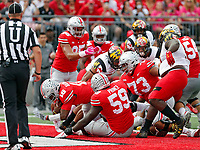 Ohio State Buckeyes quarterback J.T. Barrett (16) scores a rushing touchdown against Maryland Terrapins during the 1st quarter at Ohio Stadium in Columbus, Ohio on October 7, 2017.  [Kyle Robertson/Dispatch]