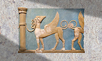 Minoan high relief wall art fresco of Griffins, Gret East Hall, Knossos. 1600-1450 BC. Heraklion Archaeological Museum.<br /> <br /> This minoan high relief fresco decorated the Great East Hall of Knossos palace. The decoration of the hall included religious scenes depicting boxing, and bull leaping games.