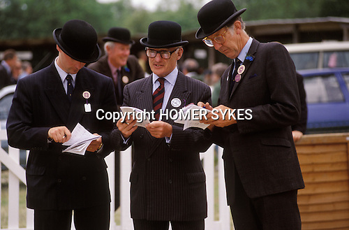 Judges in bowler hats judging  South of England County Show Kent.