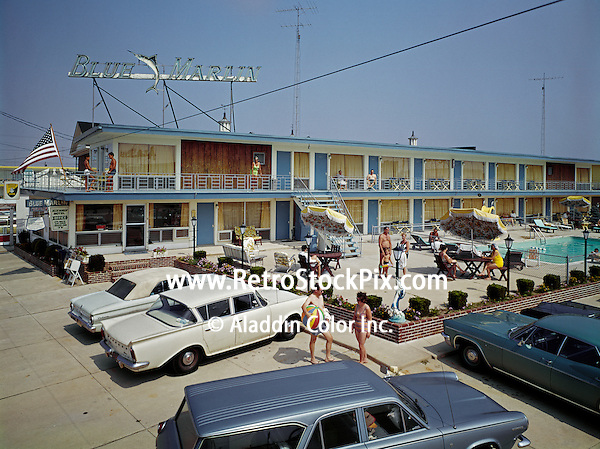 Blue Marlin Motel Wildwood,NJ. Exterior of motel with neon sign & old cars.