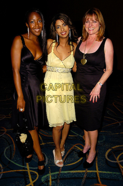 """ANJELLICA BELL, KONNIE HUQ & JANET ELLIS.Cystic Fibrosis Trust """"Breathing Life Awards"""" .at the Hilton Metropole Hotel, London, England,.May 31st 2007..full length yellow dress black dress.CAP/CAN.©Can Nguyen/Capital Pictures"""