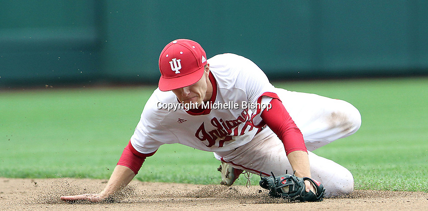 Colby Stratten snags the ball to make the final out of the eighth inning. The Hoosiers lost 5-3 to Maryland in the opening game of the Big Ten Tournament at TD Ameritrade Park in Omaha, Neb. on May 25, 2016. (Photo by Michelle Bishop)