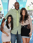 Kourtney Kardashian,Lamar Odom & Khloe Kardashian at Fox Teen Choice 2010 Awards held at he Universal Ampitheatre in Universal City, California on August 08,2010                                                                                      Copyright 2010 © DVS / RockinExposures