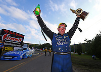 Oct 2, 2016; Mohnton, PA, USA; NHRA funny car driver Tommy Johnson Jr celebrates after winning the Dodge Nationals at Maple Grove Raceway. Mandatory Credit: Mark J. Rebilas-USA TODAY Sports