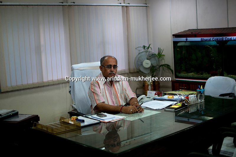 Ashish Kumar Sarkar, Director, Planning and Project poses for a photo at his office in BCCL (Bharat Coking Coal Limited) headquarters in Dhanbad, Jharkhand, India.