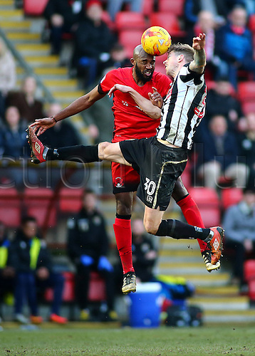 February 18th 2017,  Matchroom Stadium, Leyton, London, England, Skybet Division 2 football, Leyton Orient versus Notts County;  Nigel Atangana of Leyton Orient and Jonathan Stead of Notts County both climb high and attempt to head the ball