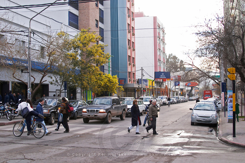 View of the main street. cars and traffic. pedestrians at a pedestrian crossing Neuquen, Patagonia, Argentina, South America