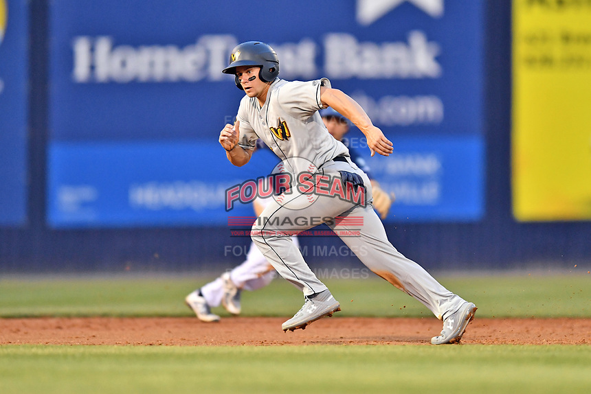 West Virginia Power center fielder Jarred Kelenic (10) runs to third base during a game against the Asheville Tourists at McCormick Field on April 18, 2019 in Asheville, North Carolina. The Power defeated the Tourists 12-7. (Tony Farlow/Four Seam Images)