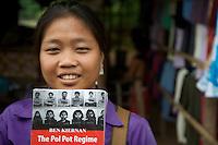 Girl vendor selling Books on Pol Pot at Ta Prohm, Siem Reap Cambodia