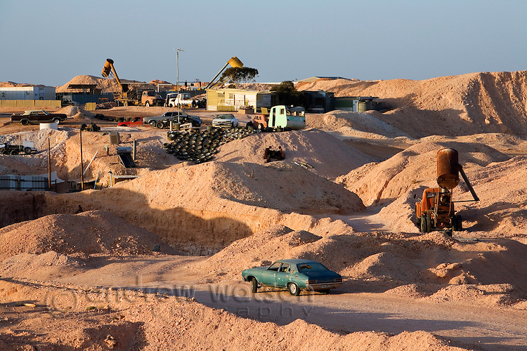 An underground home dug into the hillside while mining continues around it.  Coober Pedy, South Australia, AUSTRALIA.