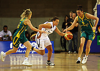 Tall Ferns guard Susie Bates drives between Jessica Bibby and Hollie Grima during the International women's basketball match between NZ Tall Ferns and Australian Opals at Te Rauparaha Stadium, Porirua, Wellington, New Zealand on Monday 31 August 2009. Photo: Dave Lintott / lintottphoto.co.nz