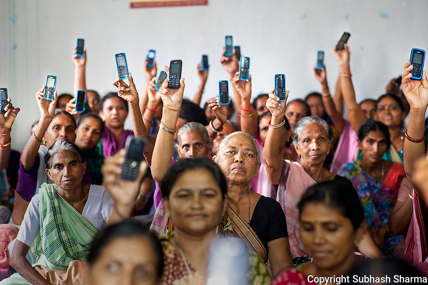 16 July 2014 - Ahmedabad - INDIA :<br /> Rural Women proudly show their Mobile phones as a means of earning their livelihood. The RSV mobile APP enables the women entrepreneurs in the network to capture sales and place orders for additional stock via SMS using their basic feature phones. Access to a mobile device can be life-changing, particularly for women. Research has revealed that 9 out of 10 women in developing markets feel safer because of their mobile phones; 8 out of 10 feel more independent with access to mobile technology and more than half have used a mobile phone to earn additional income. Combining access to mobiles with value added services can result in a dramatic increase in productivity.<br /> <br /> Established by SEWA in 2004, the Rural Distribution Network (RUDI) is an agricultural cooperative with 3,000 members, most of whom live in India&Iacute;s Gujarat state. RUDI products, which are recognized for their quality and affordability, are sold through a network of RUDI saleswomen known as RUDIbens. Together with SEWA and the Vodafone Foundation in India, The Cherrie Blair Foundation launched the RUDI Sandesha Vyavhar (RSV) mobile APP, enabling RUDIbens to place orders and manage and track their sales via a basic mobile handset. The APP enables the women entrepreneurs in the network to capture sales and place orders for additional stock via SMS using their basic feature phones. The capacity of mobile phones to change women&Iacute;s lives is developing at a rapid pace, and the RSV mobile application is an example of real results in a short time. <br /> The RSV APP Project is the winner of the 2014 GSMA Global Mobile Award for Best Mobile Product, Initiative or Service in Emerging Markets and the 2014 mBillionth Award for mWomen &amp; Children.