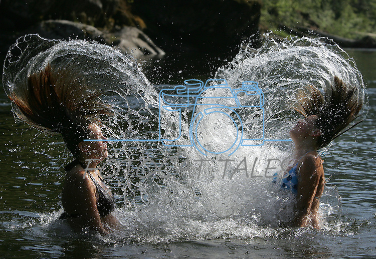 Sisters play in Kelly Creek, near Pierce, Idaho on July 27, 2007..Photo by Cathleen Allison